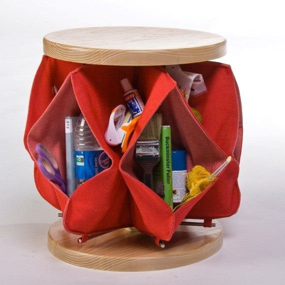 A round storage solution with pencil cases attached together around a central point