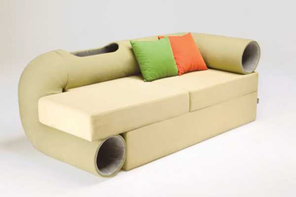 Cream day bed style sofa with tube circling the sofa for cats to climb through