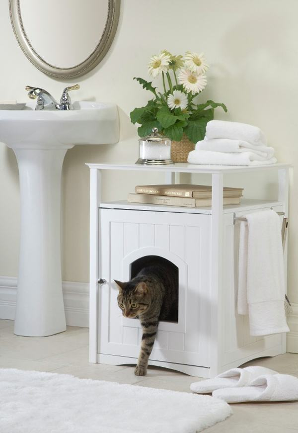 Cat bed inside a white bathroom cabinet