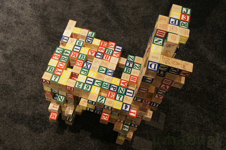 A kids chair made from lots of lettered blocks