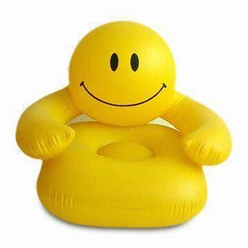 Yellow inflatable smiley face chair