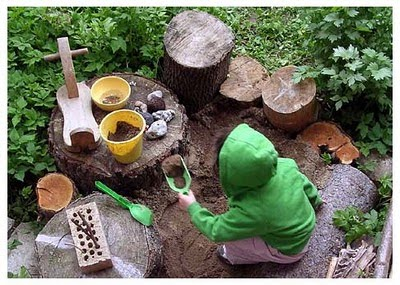 A child playing in a garden mud kitchen