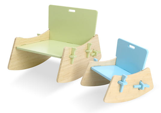 Natural wooden rocking chairs, one with a light green back rest, the other with a light blue back rest