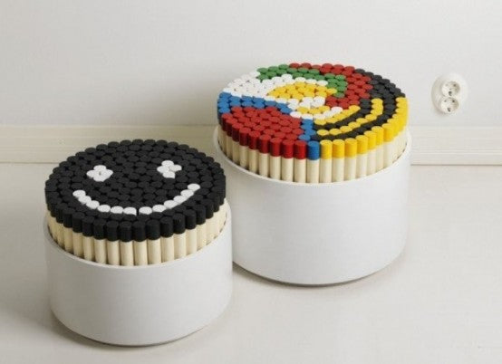 Tub stools with coloured rods that can be removed and rearranged to make your own patterned seat