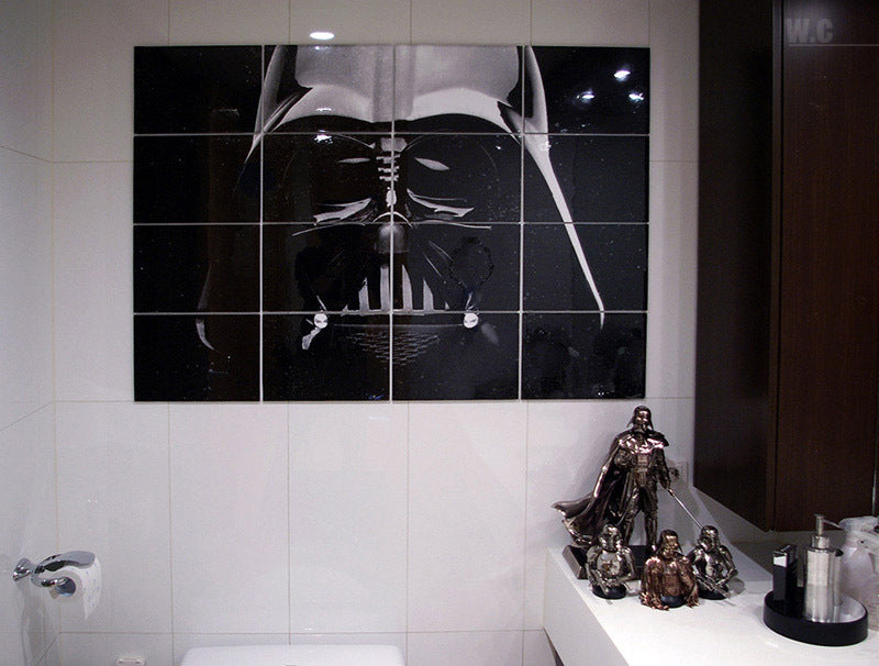 Black mosaic image of Darth Vader in a white tiled bathroom