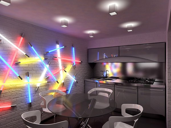 Grey kitchen with metallic units, with lightsabers on the wall to light the room