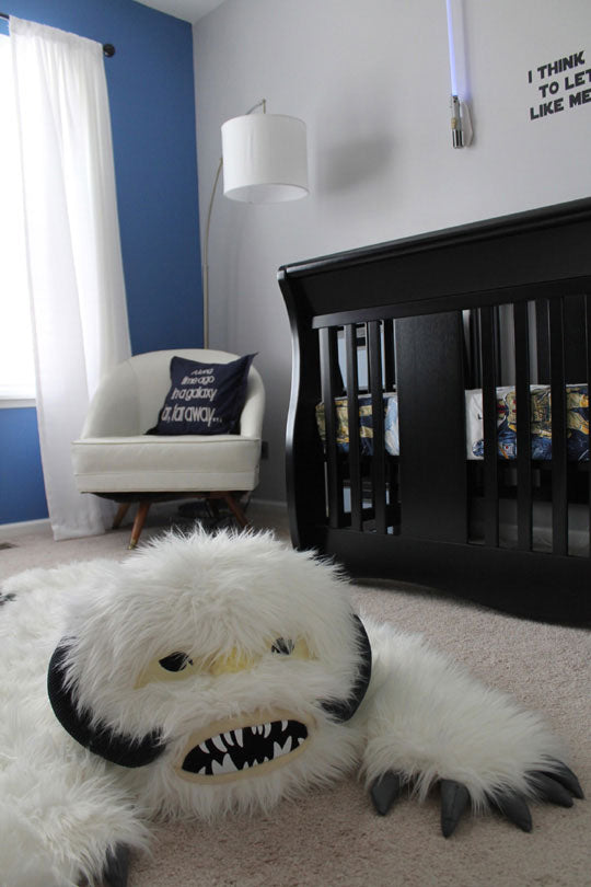 Black, white and blue childrens nursery with white Wampa rug from Star Wars