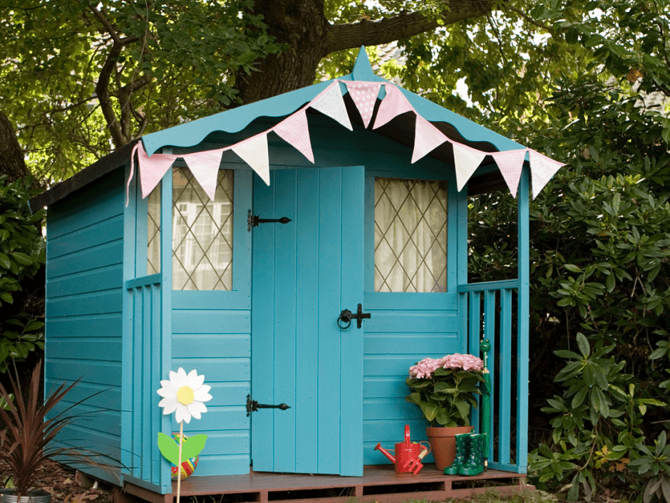 Funky Blue Beach Hut Shed, Decorated With Bunting and A Plant Pot
