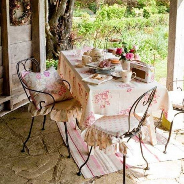 Cream And Pink Floral Tablecloth On A Patio Table