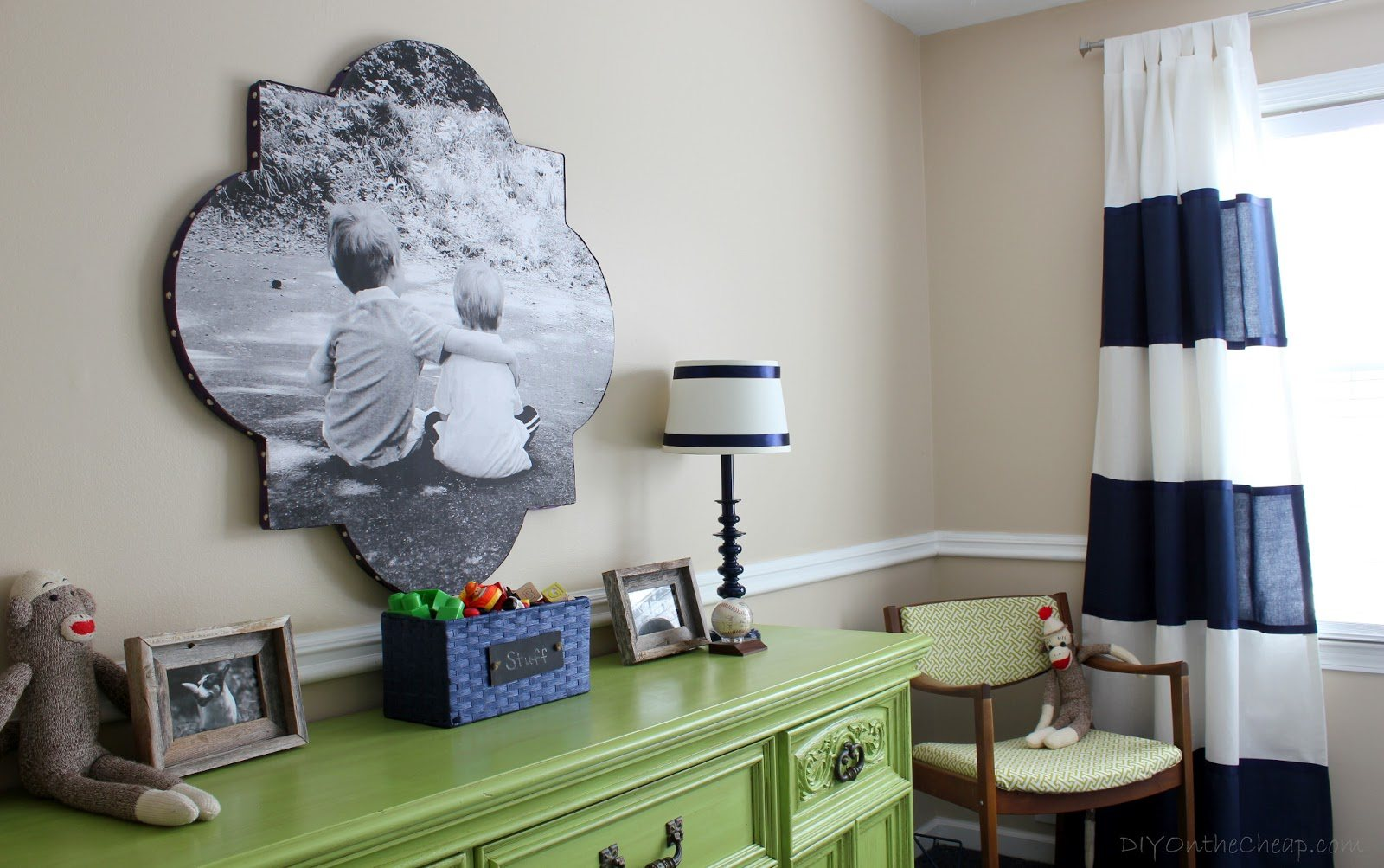 Green Traditional Bedroom Drawers, With Black And White Photo Of Two Children On The Wall