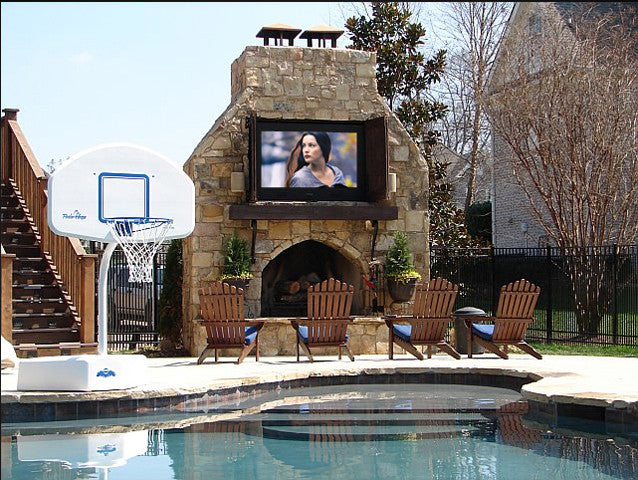 Garden Swimming Pool With Basketball Hoop And Four Deckchairs Facing TV Screen Playing Lord Of The Rings