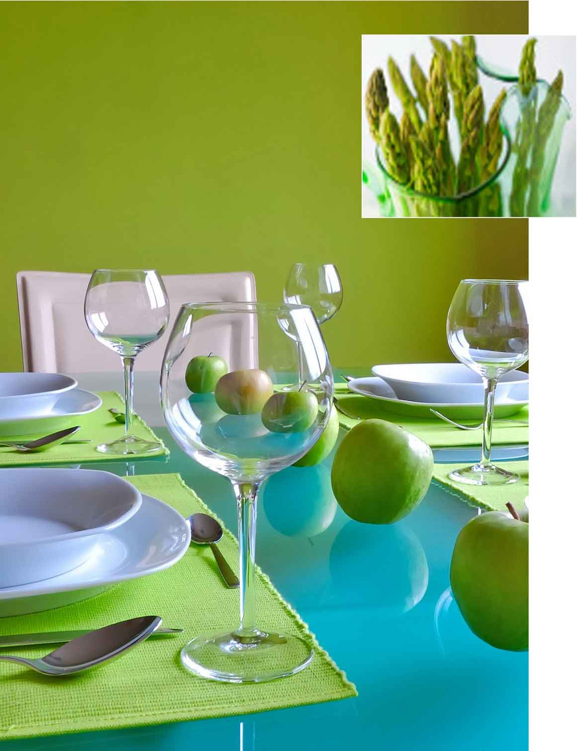 Light green and aqua dining room, with green apples on the table in a row