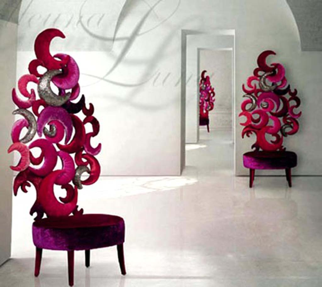 Swirling backed red chairs dotted around in three different white rooms, next to door ways