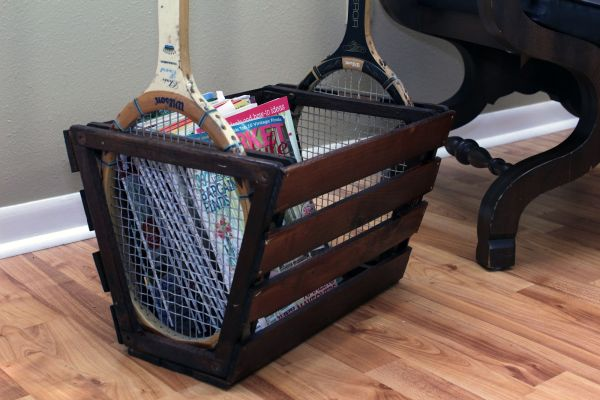 Traditional tennis racket with frame over the oval racket, then used to make a magazine rack