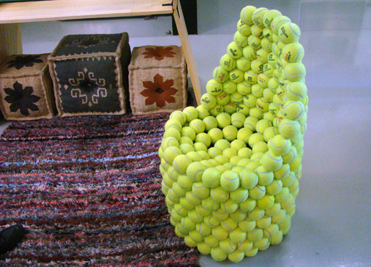 A small seat made from tennis balls