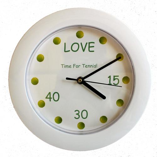 A white wall clock with tennis balls at each hour position