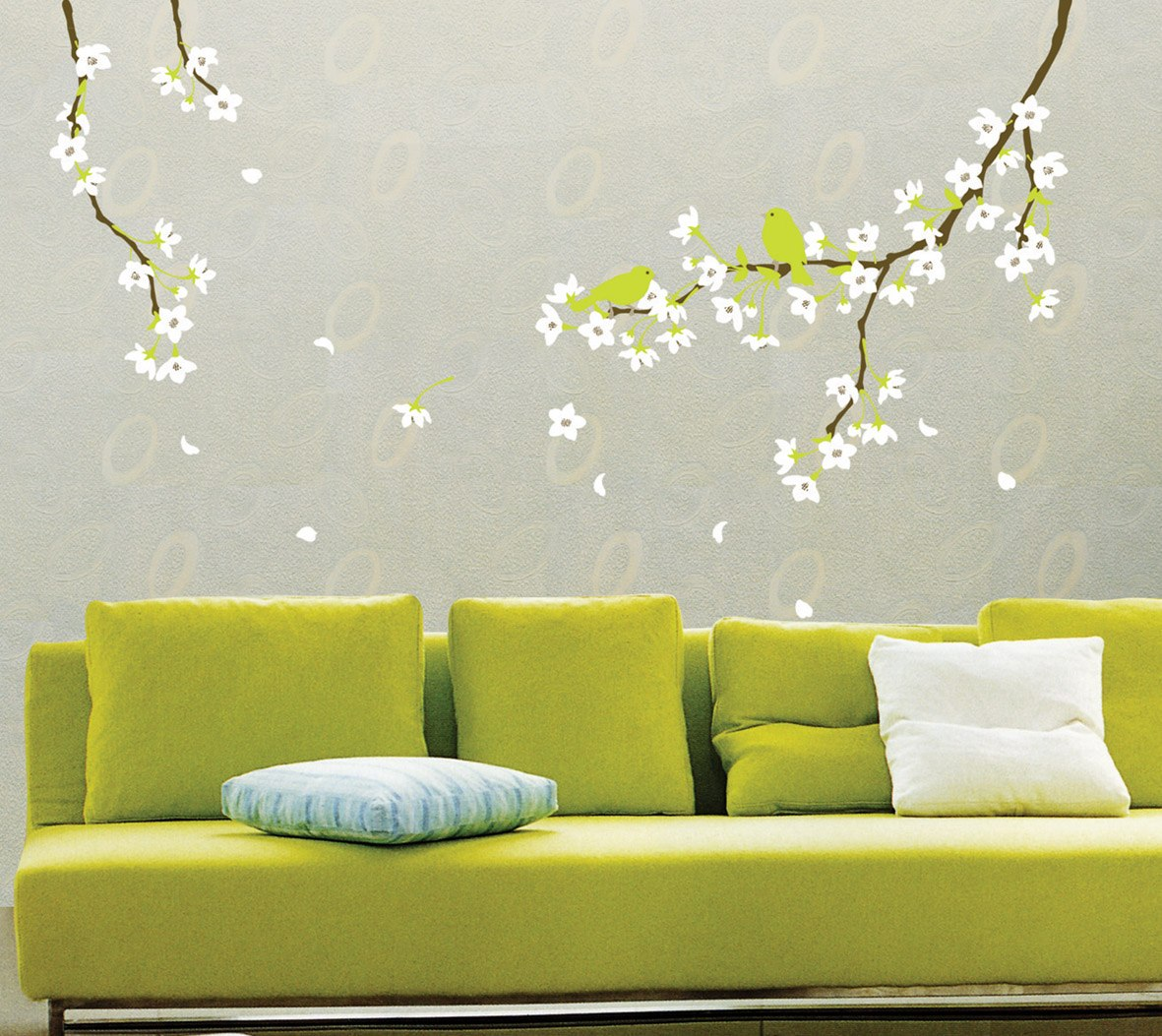 Green Sofa, White Cushions And Tree Branch Decal On Background Wall