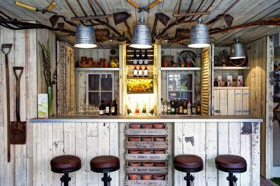 Funky Garden Shed Transformed Into A Wine Bar With Bar Stools