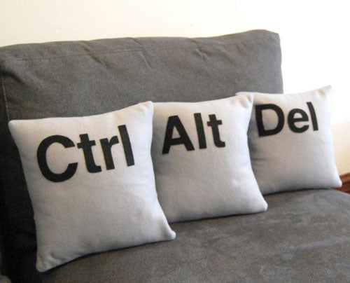 Three white cushions, one says Ctrl, the second Alt and the last Del