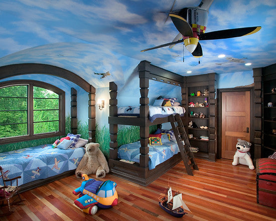 A birght blue kids room with a sky scene painted on the ceiling and propellers and planes throughout the room