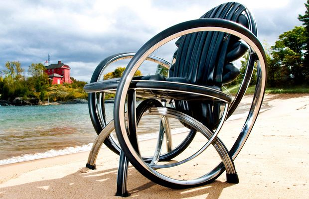 Chair made from bicycle tyres, places on a sandy beach by the sea