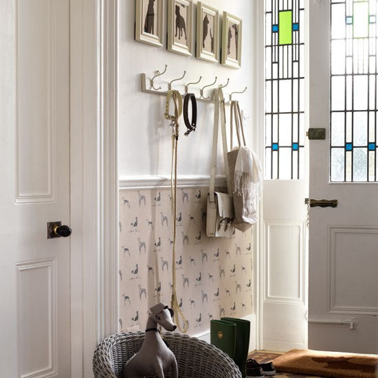 White and cream entrance way with dog collar and lead hung on a coat peg
