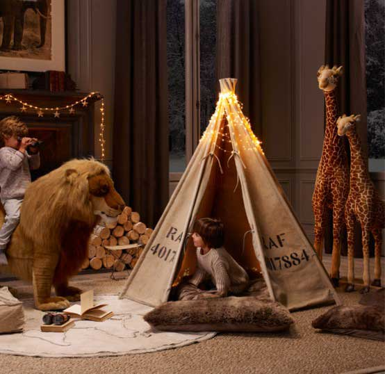 Safari themed play time with canvas tent, large ridable lion and toy giraffes