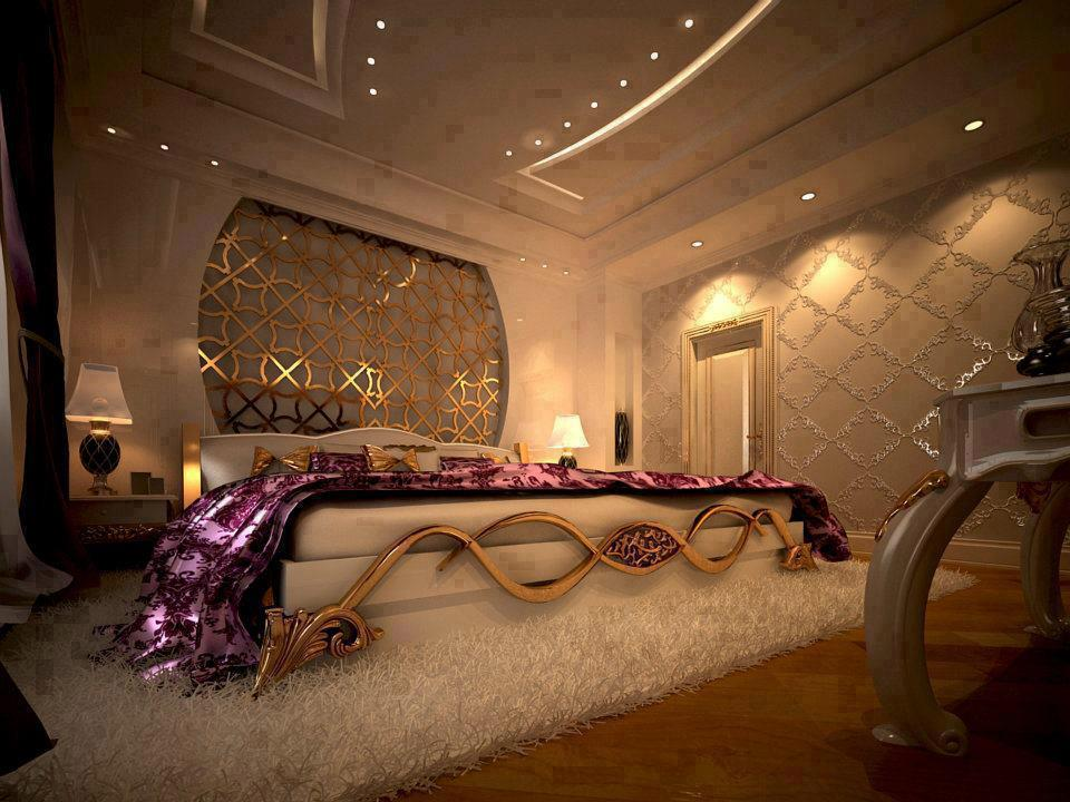 Beige, gold and cream bedroom with wide cream bed with gold coloured metallic swirling designs on the foot of the bed