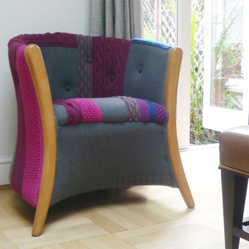 Grey armchair with extra upholstered sections in pink, purple and blue