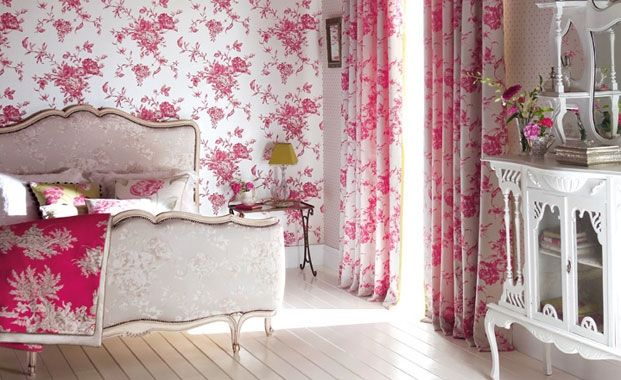 White and pink wallpaper and matching curtains in a bedroom with a beige bed