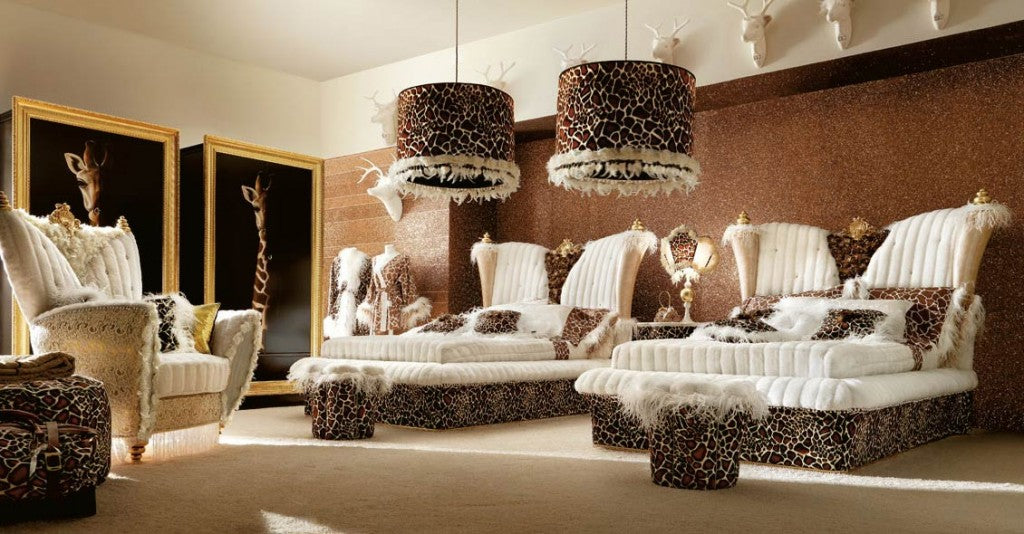 Cream, brown and beige bedroom with two double beds and giraffe print fabric used throughout