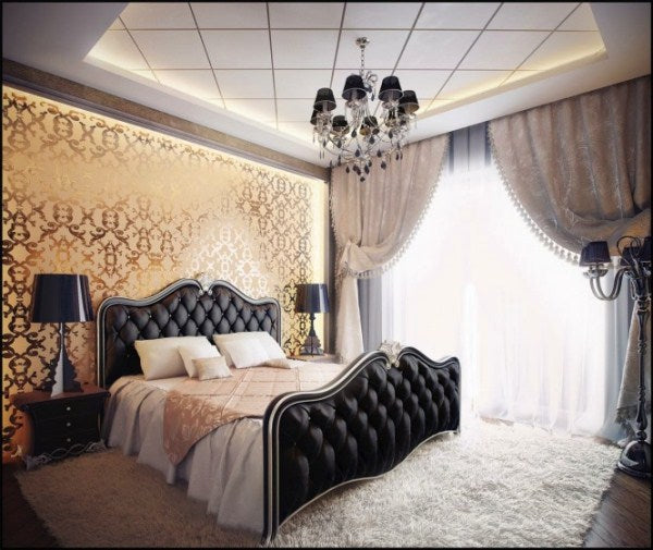 Black, cream and gold bedroom with lots of light coming through the voile curtains