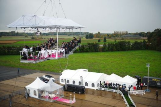 Wedding Ceremony On Suspended Platform Above An Outdoor Concrete Floor
