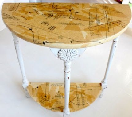 A semi-circle side table with natural wooden top and white legs