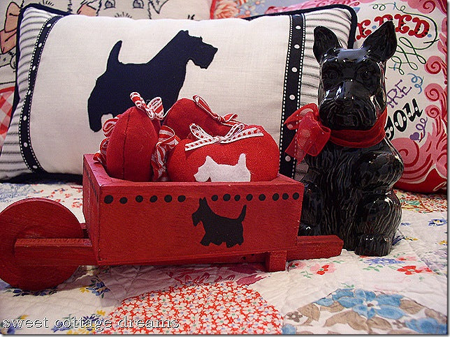 Scottie dog blue and white cushion, and matching black dog ornament