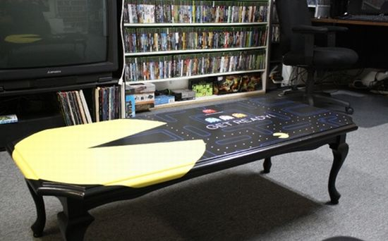 Black table with Pacman decal and game layout