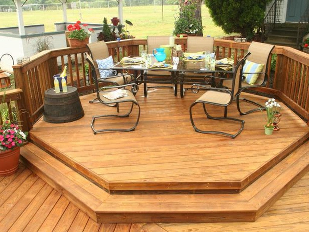 Octagonal outdoor decking platforms with table and seats on the top
