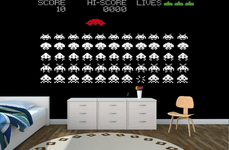 Space Invaders themed wall decal in a kids bedroom