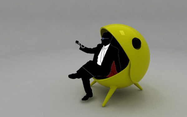 Yellow Pacman pod chair, with a mouth that closes