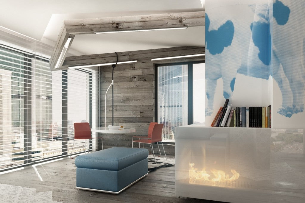 White, grey and blue room with small round table suspended from the ceiling and blue ottoman