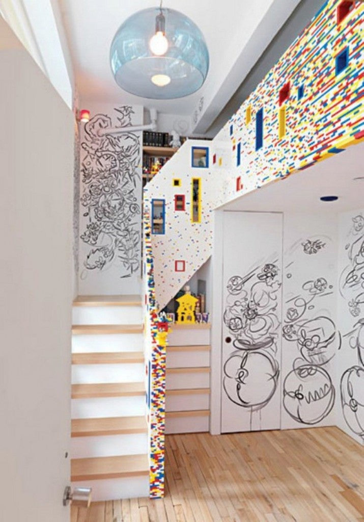 Kids Lego bedroom, mostly white but with bright Lego bricks used within the staircase