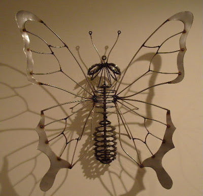 A metal wall decoration shaped like a butterfly