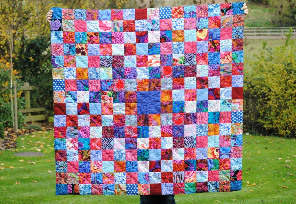 Patchwork quilt in dark blue, pink and light blue