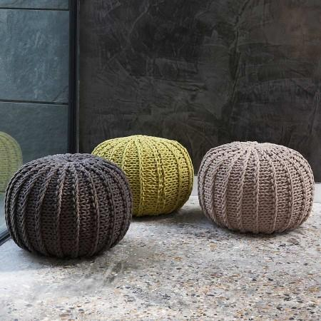 Three woven wool footstools that look like giant balls of wall