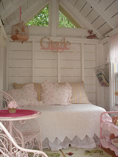 Quaint White And Pink Shed Interior With Bed And Coffee Table