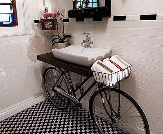 Bicycle used as a support for a sink shelf unit in a bathroom