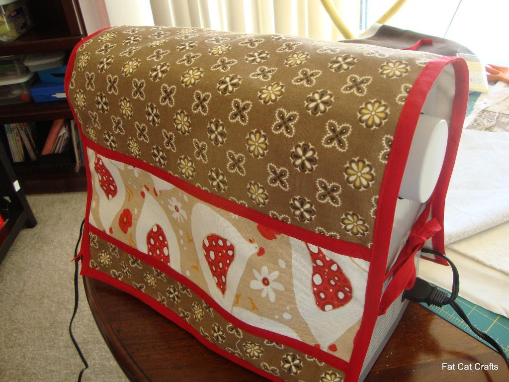 Brown, red and beige cover for a sewing machine