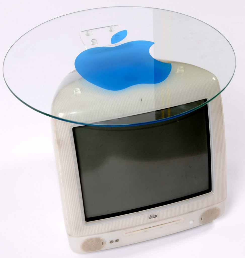 Retro Apple iMac computer turned into a coffee table with glass top