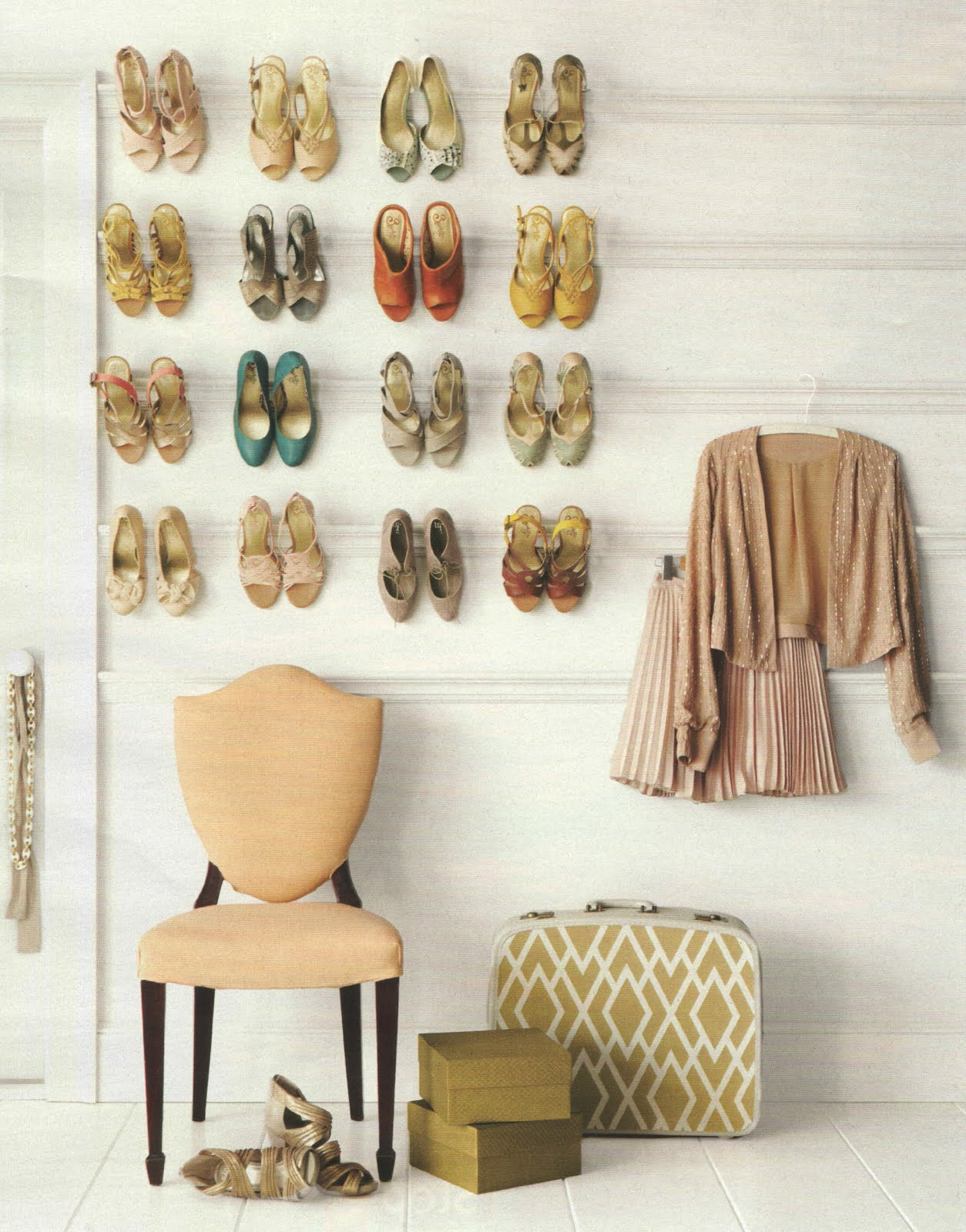 Lots of women's shoes hung on a wall by the heel using transparent rods