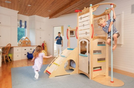 Cream and natural wood kids room with indoor climbing frame and firemans pole